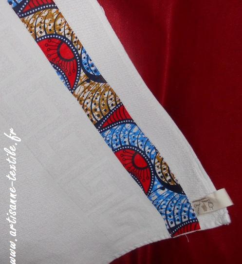 couture d'une serviette et du pagne
